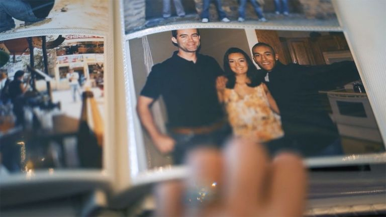 Photo in a photo album of Beatriz Mckee sharing a hug with her husband Tom and her brother Oscar.