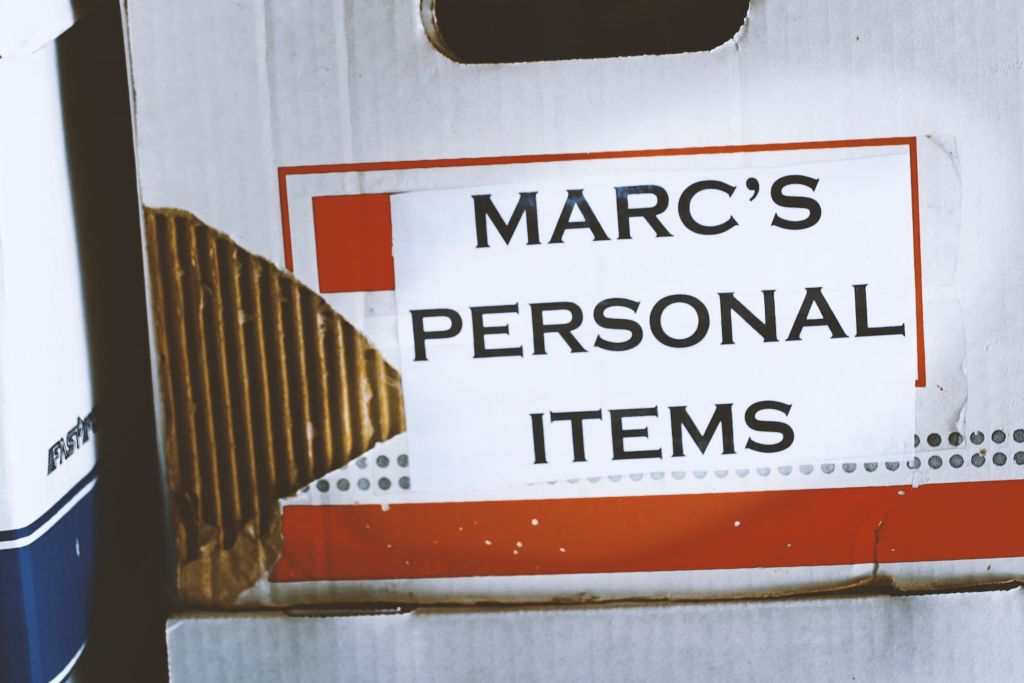 An old file folder box labelled with the words Marc's Personal Items