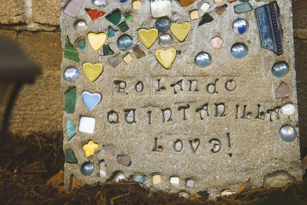A concrete and mosaic block with shiny tiles and heartsreads Rolando Quntanilla Love!