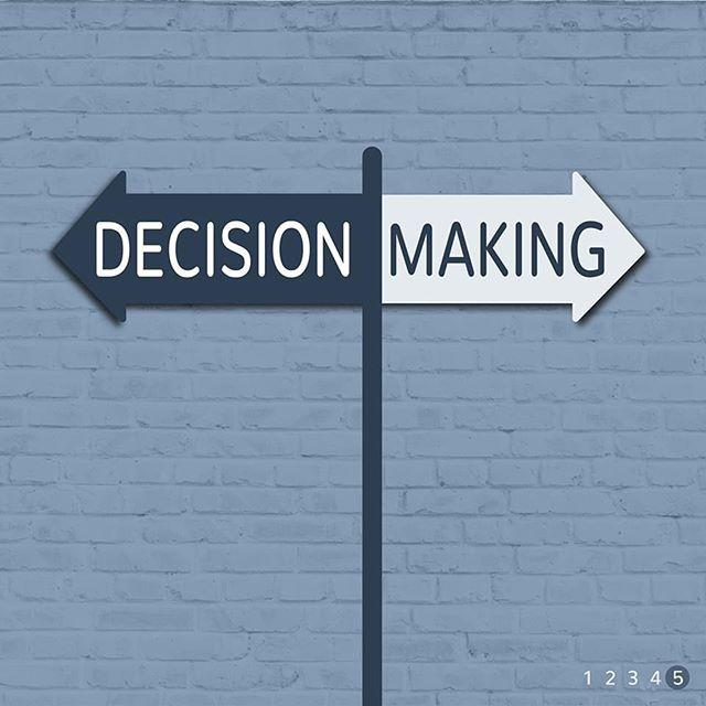 A sign that reads decision making, with arrows on the sign pointing in opposite directions